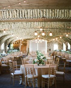 On the Ceiling of Your Indoor Reception Venue | 7 Places to Use String Bistro Lights at Your Wedding | https://www.theknot.com/content/7-places-to-use-string-bistro-lights-at-your-wedding