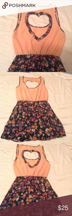 Heart Cut Out Mini Dress Heart Cut Out Mini Dress. Orange top which is slightly see-through with a floral bottom. The heart cut out in the back has a floral outline. Worn once. Open to reasonable offers! Reverse Dresses Mini