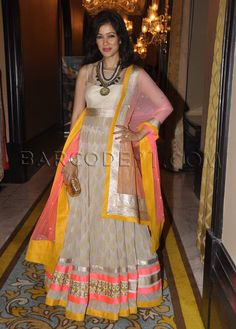Vidya Malvade wore a cream brocade anarkali with bright yellow and pink border