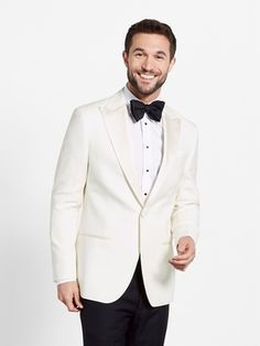 Traditionally a warm weather alternative to a full black tuxedo, this white dinner jacket elevates your look no matter the season. Styled with silk grosgrain peak lapels, the ivory wool strikes a subtle contrast when paired with a crisp white dress shirt.  Delivered with our black tuxedo pant for a timeless look. 100% wool faille.  <b>Only jacket sizes 36-44 are available for this style.</b>