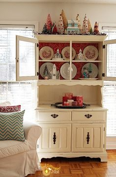Pretty Christmas China cabinet decorating ideas. Bottle brush trees, glitter houses, red transferware and red and aqua colors. So cute!