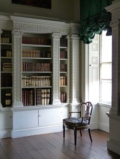 library at Osterley Park House - Robert Adam notice cupboard at the base. good for picture albums, board games etc.