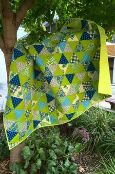 "Suz from PatchworknPlay chose Denyse Schmidt Quilts and Robert Kaufman Fabrics Kona to make her first bright and colorful triangle quilt!   ""I used my favourite thread- #Aurifil! No.1231, which I call Pacific Lime of course!""  To see more please visit http://patchworknplay.blogspot.com/2015/04/another-finish.html"