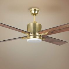 Clean design on this four-blade LED module light ceiling fan is highlighted with an inviting satin brass finish. Style # at Lamps Plus. Gold Ceiling Fan, Best Ceiling Fans, Ceiling Lamp, Ceiling Lights, House Ceiling, Ceiling Fan Makeover, Contemporary Ceiling Fans, Wire Installation, Slanted Ceiling