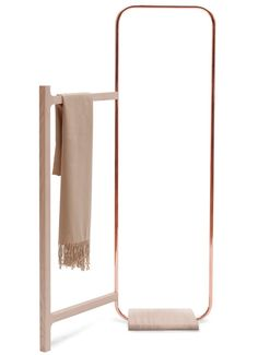 This clothes rack by German designer Meike Langer features a copper arc with a hinged timber frame, allowing it to slot into the corner of a room.
