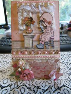Altered paper bag made with Diemond Dies Realistic Roses Die Set and Diemond Dies Small Monarch Butterfly Die Set.  Made by DT member Laura Luyando.