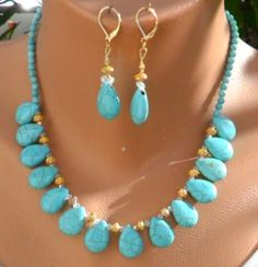 "Hand crafted Howlite Turquoise Blue color Teardrop with crystal and gold plated spacers, Necklace 17"" inches plus 3"" inch extender set. Matching Earrings : Leaver back gold plated spacers and crystals 2"" inches in length."