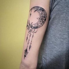 Ornamental Moon Arm Tattoo.
