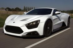 #29. Zenvo ST1. ~$1,225,000. The ST1 is a hand-built, highly-exotic model that comes with a 7.0 liter V8, both supercharged and turbocharged, which is what the ST stands for, producing a total of 1104 bhp. Side facts: Its Danish, and only 15 will be made each year. Talk about being even more exclusive than the Bugatti Veyron Super Sport. This car looks sleek, and very very pissed off.