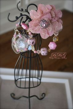Baby Boutique Pink Vintage Flower 4-in-1 Beaded Pacifier Holder. $24.99, via Etsy.