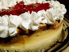 NY Style Cheesecake on a Gingersnap Crust with Cherries - a holiday favorite!
