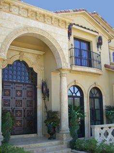 Heavy Gothic Door with a Quatrefoil Cutout Transom and Inset Decorative Panels by Potter Art Metal Studios potterartmetal.com