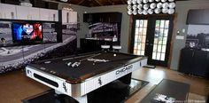 Highlight: customized pool table. Oh, and the customized bar and TV back-splash!