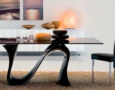 This is one of my favorite designs. Wave table by Tonin Casa is truly original and available in variety of options. Glass top comes in clear, extra white, gold or black. Extensions are an option. Base is available in white, black, gold or silver.