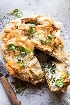 Sharing my favorite take on Greek Spinach and Feta Pie (Spanakopita). Also known as flakey, buttery, phyllo dough spinach pie with cheese. SIDE NOTE: I semi hate the abbreviatio Spinach Recipes, Vegetarian Recipes, Cooking Recipes, Healthy Recipes, Greek Food Recipes, Healthy Food, Cooking Food, Easy Cooking, Vegan Vegetarian