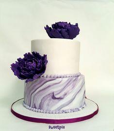 Purple peonies marble effect wedding cake