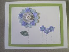 One large, 3 small flowers with green mat