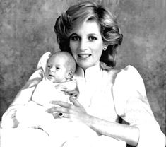 Diana Princess of Wales with her young son Prince Harry in a photo taken by Lord Snowdon at Kensington Palace Oct. 4, 1984.