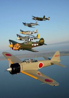 Mitsubishi A6M Zero, Curtis P-40 Warhawk, North American P-51 Mustangs,  Vought F4U Corsair, Mitchell B-25 bomber at airshow