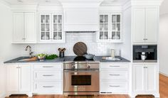 Kitchen Remodeling Ideas Kitchen of the Week: New Layout, Lots of White Freshen Things Up New Alert Small Kitchen Redo, Updated Kitchen, Cabinet Door Styles, Glass Cabinet Doors, Cabinet Ideas, Elegant Kitchens, Black Kitchens, White Kitchen Cabinets, Kitchen Cabinetry