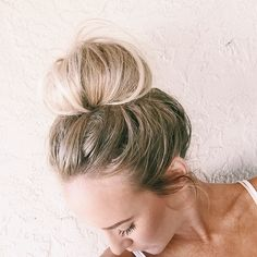heres a look at how we do our signature messy top knot!    what you'll need: -hair tie -bobby pins -comb  Instructions: 1. start by teasing the front sectio