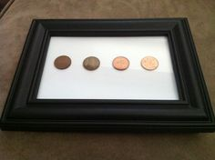 """Copper"" 7th wedding anniversary. First two pennies are each persons birth year, 3rd year we met, 4th year married. And put in a frame :)"