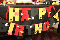 Took a dollar store banner and painted it and just added mickey mouse cut outs @Krissy Mummert Sexton