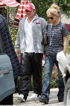 Jessica Simpson wearing Edun Rainer Maria Rilke sonet tee, lanvin jet set bag, bing bang earings and Hysteric Glamour burner wash jeans