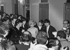 Is Mick Jones somewhere in that crowd? The Beatles with Sylvie Vartan at the Olympia in 1964. (Getty Images)