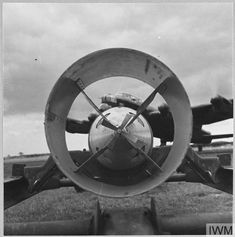 Original wartime caption: For story see CH.7484. Picture issued 1942. Through the tail of a bomb - a giant Lancaster ready to take off on a raid. Lancaster Bomber, Royal Air Force, Caption, Lincoln, Manchester, Aircraft, York, Aviation, Captions