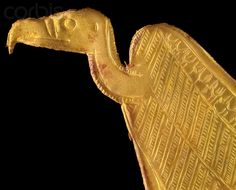 Gold amulet in shape of vulture from tomb of Tutankhamun: Amulet in the shape of the vulture. As this figure is very frequent it seems to appear as a symbol of the Upper egyptian goddess Nekhbet so maybe she is represented here but the vulture was also sacred to the mother goddess Mut and it might be she who is depicted. | Located in: Egyptian Museum, Cairo.