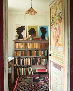 A door painted by Vanessa Bell in 1918 leads out of Duncan Grant's bedroom into his dressing room at Charleston Farmhouse in Sussex. On entering you are immediately faced with silhouette depictions of the Grant family.