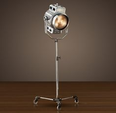 """This 1940s Hollywood Studio Floor Lamp is industrial in mien and function, our exacting reproduction of a 1940s Hollywood studio light. It is as solidly built and maneuverable as its predecessors. Originally designed to illuminate the famous faces of film, the height adjusts manually from 47"""" to 67"""". Crafted of solid cast aluminum and steel, it's a classic of the genre. $1,595"""