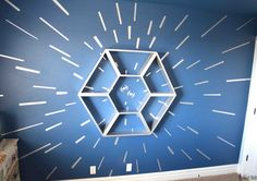 An awesome Star Wars bedroom with a hyperspace focal wall and fighter cockpit Star Wars Shelf. The boys are going to love this!!!