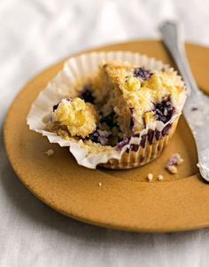 Just-picked corn, plump blueberries, and a dusting of raw sugar kick this Blueberry-Corn Muffin recipe up a notch. #brunchideas #recipes