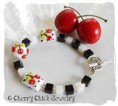 Triple Cherry Checkerboard Lampwork Beaded Bracelet in White  #Lampwork #CherryLampwork #CherryBracelet #CherryJewelry #Checkerboard #CherryChick #BeadedBracelet