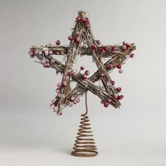 Our Iced Berry Twig Tree Topper is handcrafted of real twigs to add a rustic grandeur to any holiday display. The tree topper is designed as a five-pointed star and rests on a coiled metal base to stand out from the top of your pine tree.