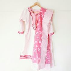 Pink White Short Salwar Kameez Foral 3 peice My mom wore this once last year but it looks brand new.  THE PICTURE OF THE DRESS LOOKS WEIRF BC THE DRESS HANGER IS TO SMALL FOR THE DRESS, IN PERSON IT LOOKS FINE!! :D  Size 44 (fits L to XL) Dresses Midi