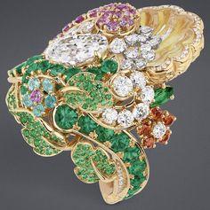 "DIOR 2017. ""Diamond Ballroom Grove"" ring in yellow gold, diamonds, rock crystal, emeralds, pink sapphires, tsavorite garnets, rubies, spessartite garnets and Paraiba tourmalines #DIOR #DIORÀVersaillesCôtéJardins #DIORJewellery #HighJewelry #FineJewellery #HauteJoaillerie"