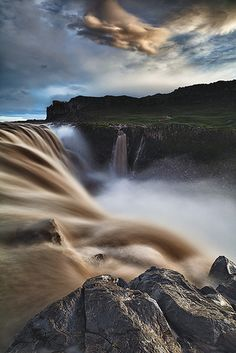 Eye-level view of Dettifoss Falls in Iceland, the most powerful waterfall in Europe