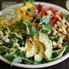 Coconut Curry Thai Salad - Add 1c coconut milk, 3tbsp creamy peanut butter, 3tbsp lime juice, 1 tbsp curry powder and 1/2tsp salt to a blender. Blend until smooth. Refrigerate dressing about 2 hours to thicken.  Add Spring green mix, 1 chopped mango, 1/2 sliced red pepper, 1 sliced avocado, 4 stalks chopped green onion and 2/3c roasted cashews to a serving bowl. Drizzle w/coconut curry dressing, toss and garnish w/chopped cilantro.