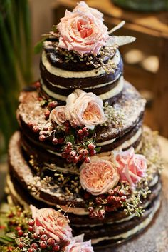 Chocolate dream wedding cake with gorgeous rose and berry accents || Selected by Finepointwedding.com