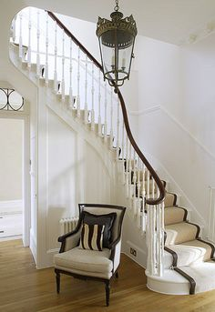 fabulous painted staircase w/ sisal runner banded in chocolate leather with brass rods