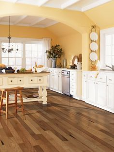 Different shades of darker hardwood flooring in this spacious kitchen.