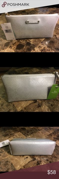 """New Kate Spade Metro Little Shiloh Bag silver Bag New with tags Kate Spade Metro Little Shiloh silver bag.  Bags can be used as a make up bag. Ba. Measures 8""""x4.25"""" with base 2"""" wide. kate spade Bags Cosmetic Bags & Cases"""
