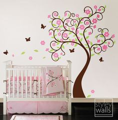 Tree Wall Decal Wall Sticker Wall decal Flower tree decal Cherry blossom Curly Flower Tree Butterflies Kids Children Nursery Wall Decal. $105.00, via Etsy.