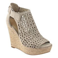 The Helina is an espadrille wedge suede sandal detailed with a laser cut design, jute sidewalls and adjustable Velcro ankle strap.