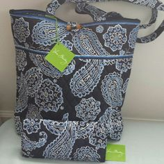 """NWT Vera Bradley Tote matching wallet blue bandana 100% Authentic Vera Bradley Tote Blue Bandana (10449-286) matching trifold wallet (13947-286) Brand new never worn, Tote size is 11 3/4wx13 1/2 Hx4 D, strap drop 12 1/2"""" , three interior pockets, removable base board, Trifold wallet size is 8 1/4 wx 4Hx 3/4 D, Hidden magnetic closure, inside 11 card slots, three long bill pockets , ID window and one photo window, zippered pocket on back for coins. Vera Bradley Bags Totes"""