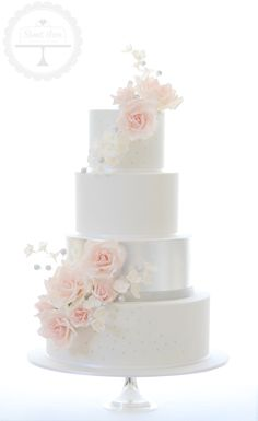 The ultimate in elegant wedding cakes - featuring edible silver leaf and sugar flowers