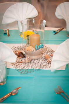 Beach wedding centerpieces. Vases and candles from Michael's, shells and sand from Mayport beach in Jacksonville, FL.